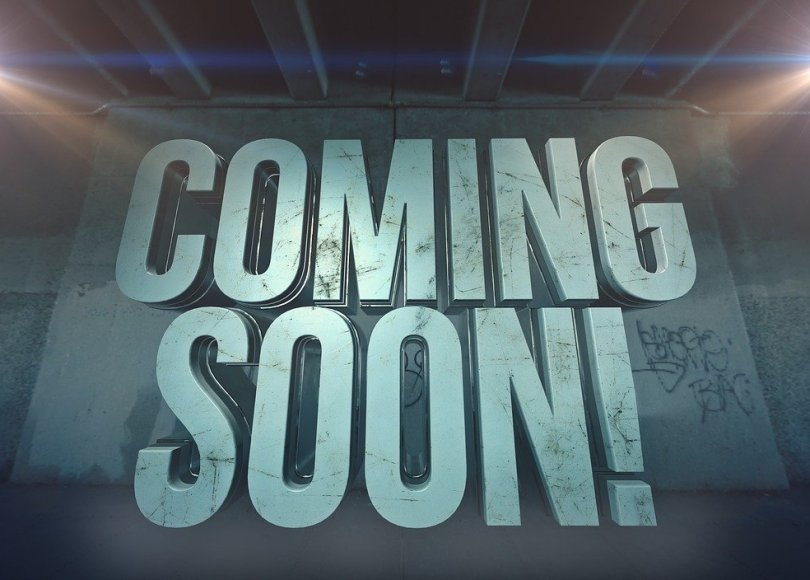 'Coming Soon' written in capital letters with spotlights on either side.